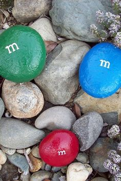 Love these painted m&m rocks 51 Budget Backyard DIYs That Are Borderline Genius
