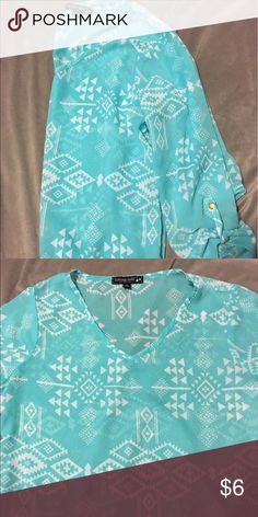 Turquoise silky tribal Tunic Turquoise and white tribal print Tunic. Long sleeve. Can be put to 3/4 sleeve because of buttons attached. Top is silky, shear and very thin. Worn once. Perfect condition. Size large Living Doll Tops Tunics