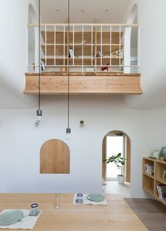 Alts Design Office uses arches and curves throughout Outsu House in Japan