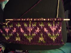 hooks-and-chains:  I'm converting a Fair Isle knitting pattern into Tunisian crochet and I am in love. Yarn is Loops and Threads Charisma in Dark Purple and Bouquet. Pattern: http://www.purlbee.com/the-purl-bee/2012/1/3/whits-knits-little-fair-isle-hat.html (it is actually for a baby sized hat so I heavily modified it but the pattern is darling)  Ooo, I looove the look of colorwork in tunisian.