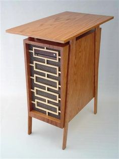 """Mid Century Madness"" by Jeffrey Stephenson. A red oak mid-century modern-styled computer enclosure inspired by the TV show Mad Men."