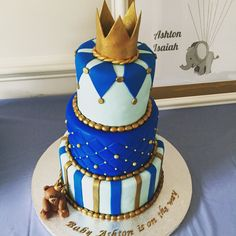 It's a boy, baby shower cake. Baby blue, royal blue and gold.