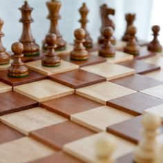 Might just have to add this to the list for someday...3D Tiered Solid Sapele Wood Chess Set - English - Chess Sets at Hayneedle