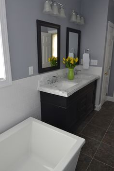Grey, black and white bathroom. White soaking tub, white wainscotting, dark vanity and mirrors, grey countertop. Basement Wainscoting, Wainscoting Height, Dining Room Wainscoting, Wainscoting Panels, Wainscoting Ideas, Grey Countertops, Diy Bathroom Remodel, Bathroom Remodeling, White Bathroom