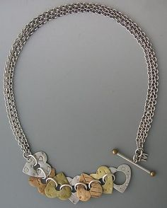 """""""Recurring Love Necklace"""" by Thomas Mann ... I love designs that bring the closure to the front"""