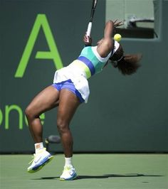 Looks like Serena was attacked by the fuzzy yellow ball in this pic...Is she okay? (@TheFanChild)   Serena Williams in her second round match at the 2013 Sony Open Tennis event.