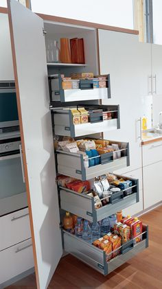 Blum TANDEMBOX larder unit. The wide pantry unit is equipped with 1 standard inner drawer, 4 high fronted inner drawers and fixed shelves at the top. Kitchen Selector By Hafele
