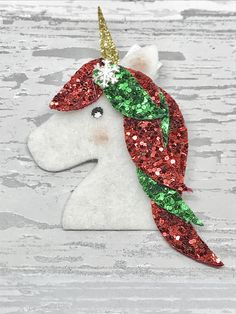 This magical hair bow set is perfect for any Unicorn fan this Christmas and is made to order personalised to your little one. The bow is created using a beautiful festive sleepy unicorn felt backed cotton fabric, paired with a red crushed velvet and coordinated with a mixed glitter