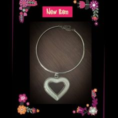 Silver choker with heart glass pendant New with out tags... This choker is adjustable for the perfect fit. The white glass gem in the middle is heart shaped! The slide can come off of the choker and can be worn by itself or you can add other slides to it. Great, versatile, piece! Jewelry Necklaces