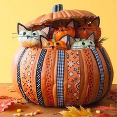 Craft this adorable pumpkin overflowing with kitties for the cutest Halloween decoration on the block.