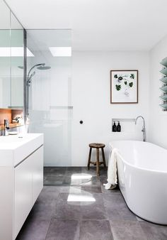 The main bathroom, used mostly by the kids, features a Posh Solus freestanding bath from Reece plus a few natural elements to help soften the overall look. The print is by Kimmy Hogan from Greenhouse Interiors. Family Bathroom, Laundry In Bathroom, Bathroom Renos, Bathroom Layout, Bathroom Interior Design, Small Bathroom, Reece Bathroom, Bathroom Ideas, Wet Rooms