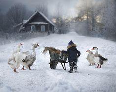 Elena Shumilova's magical, wintry photography: Geese and boy