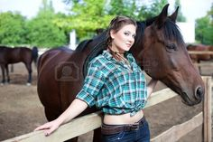Young cowgirl with a stallion