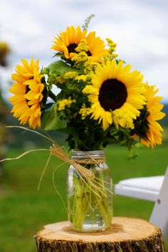 I carried a beautiful bouquet of sunflowers on my wedding day, so I& a total sucker for a beautiful floral design centered around the happy bloom. Ulysses Photography captured a day perfectly fitting of the sunflower, and can I just Sunflower Table Centerpieces, Sunflower Arrangements, Table Decorations, Wedding Bouquets, Wedding Flowers, Rustic Wedding, Wedding Day, Sunflower Party, Garden Parties