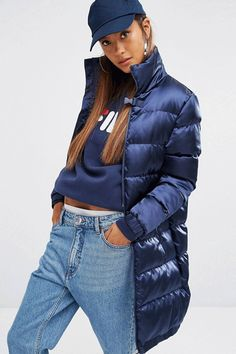 A silky, longline style from classic sportswear brand Fila. Wear yours oversized with denim and feel like a member of TLC.Fila Longline Padded Coat in Silky Fabric, $128.98, available at ASOS. #refinery29 http://www.refinery29.com/2016/08/121401/best-down-puffer-jackets-for-women#slide-5