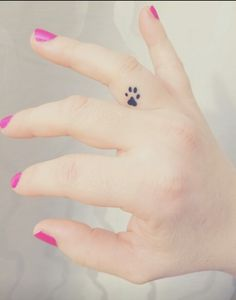 Adorable inner finger paw print tattoo *swoon*