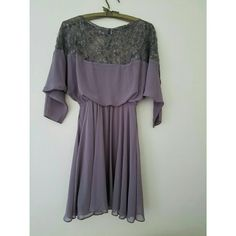 Asos lace dress Super cute just don't wear it much.  Pretty cut and gray color, lined, lace sleeves. Great condition! ASOS Dresses