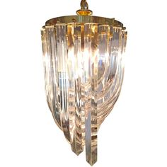 Large Lucite Ribbon Chandelier | From a unique collection of antique and modern chandeliers and pendants  at https://www.1stdibs.com/furniture/lighting/chandeliers-pendant-lights/