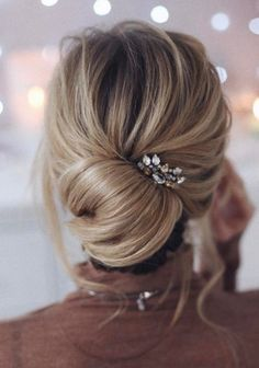 elegant twisted bun | updo | blonde | long hairstyle | with hair extensions