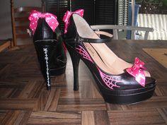Pink spider web peep-toe heels