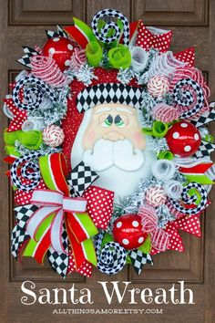 Your front door will be the talk of the neighborhood with this adorable Santa wreath! This Christmas wreath with ornaments, harlequin swirls and designer ribbon is perfect to decorate your front door or entryway this Christmas. This Santa Christmas wreath is guaranteed to make you smile this Christmas. Christmas Wreaths For Front Door, Christmas Ribbon, Christmas Snowman, Handmade Christmas, Christmas Candy, Christmas Crafts, Santa Wreath, Snowman Wreath, Snowman Decorations
