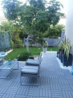 Ikea composite decking could be a really cheap interim solution for making the patio look good.
