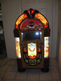 Josh has to have a jukebox in his man cave. Love this Harley Davidson one!