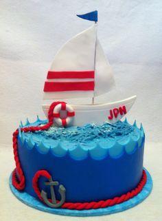 Birthday cake for a gentleman who loves to sail. Tiramisu cake, tiramisu mascarpone mousse filling and tiramisu buttercream with fondant waves and gumpaste boat. By Silver Cake Studio, Houston