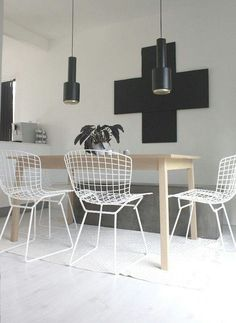 Love the look, white wire chairs, wooden table, black accessories!