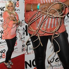 Photo – Woman with the World's Longest Nails holder ,18 inches