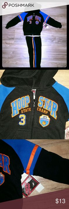 Nwt boys 2 pc jogging set Mad Game hoodie new New with tags by Mad Game. 2 pc hoodie jogging set size 18 mths and the other is 24 mths.  Please choose.   Zipper front and the words Hoop Star state champ. Color are black,  blue and orange. Get ready for Fall. Mad Game Matching Sets