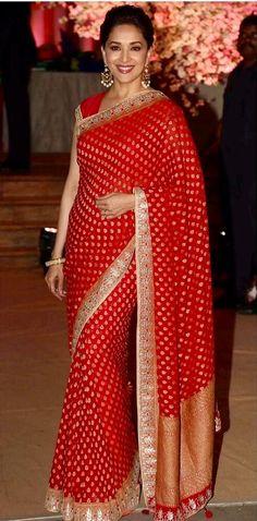 Madhuri Dixit still looking beautiful in a Anita Dongre saree.