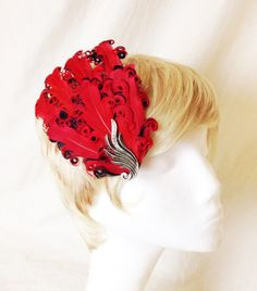 A personal favorite from my Etsy shop https://www.etsy.com/listing/241745163/red-and-black-curled-feather-and-silver