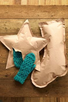 "Making packaging to be proud of requires little more than thread and scrap paper. Let warm woolen mittens and other soft goods shine--sans box--€""by layering two pieces of kraft paper together and drawing your chosen shape (star, stocking, or other Yuletide symbol) on the top piece."