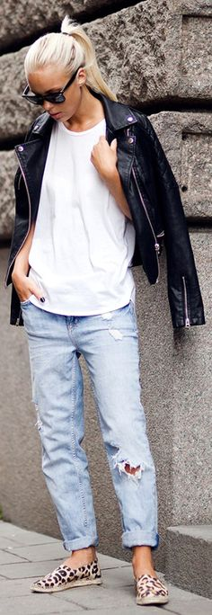 Edgy Tomboy Style: Victoria Tornegren is wearing a pair of Gina Tricot boyfriend jeans with a plain white top and biker jacket from Topshop