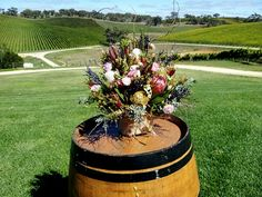 native barrel display from Maccelsfield by www.blushbloomsandevents.com