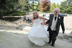 Bride and father of the bride wlaking up the steps to the front of Danson House