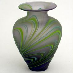 Beautiful aurora vase, a sumptious purple glass with ripples of lime green and blue made by Liam, Merlin Glass