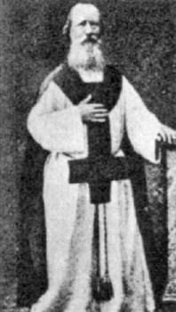 Eugene Vintras, a Frenchman who taught occult spiritual philosophy, wears the upside down cross on his religious robe and presents the sigil (hand sign) of his Order. Vintras gained a large following in the 1830s and 1840s by declaring the coming of a dark Prince, aGodon earth who would rule and reign.