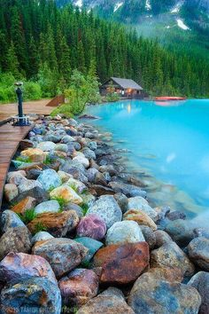 Colored stones and path leading to a canoe rental cabin nesled in the mountains on the shore of Lake Louise, Canada