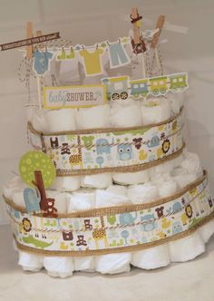 Create a gender neutral diaper cake for a baby shower with patterned paper and #GlueDots!