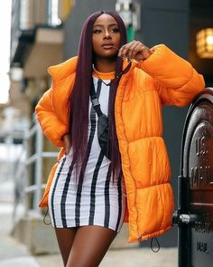 ISSA LOOK ⚡️⚡️ @justineskye in the Oversized orange puffer jacket + Orange contrast stripe dress