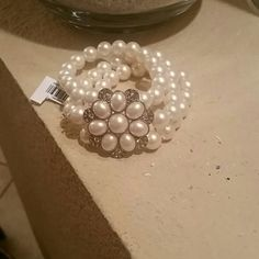 NWT tri-strand pearl bracelet. Faux pearl elastic bracelet with flower crystal and pearl accent. Never worn. Beautiful, timeless and classic...you cannot go wrong with pearls! Price is open to negotiation...happy to drop for lowered shipping, just let me know! Ann Taylor Jewelry Bracelets