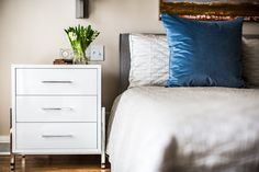 Even the simplest of designs can have a major impact. Click the image to see more photos from this renovation. Bedroom Sanctuary, White Nightstand, Color Pairing, Blue Accents, Contemporary Bedroom, Clean Lines, Neutral Colors, Interior, Color Pop