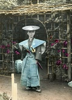 Posing in the garden.  Hand-colored photo, late 19th century, Japan.