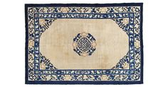 Hand-knotted Chinese Peking rug handwoven in ivory and blue with a simple medallion in the center. The patterns on vintage Chinese carpets were often taken from the patterns of the porcelain and...