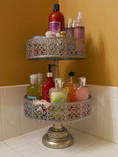 Reimagine an old cake stand as a shower gel holder! We could really use one of these to decrease countertop clutter!