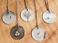 Everyday Artifact: Simple Images on Sterling Silver Pendants.  Would make unique art for dressing area.
