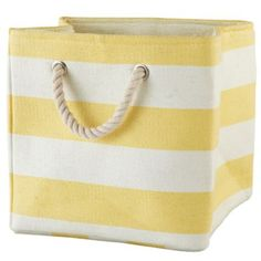 Stripes Around the Cube Bin (Yellow)  | The Land of Nod (Place a coated metal pan rack inside the bin to separate sets to make it easy to grab all the pieces when it's time to change the sheets.)