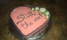 An aniversary cake, could be made into a wedding cake or valentine's cake by changing colors and writing